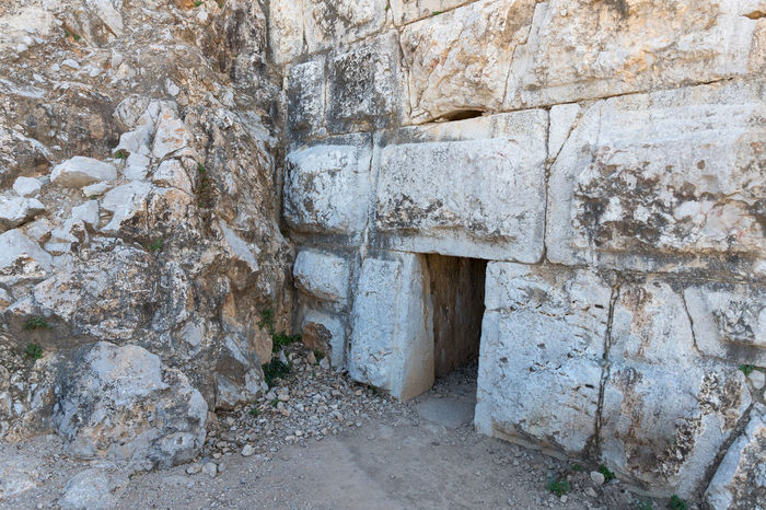The secret entrance near the north-eastern entrance to the Nimrod Fortress located in Upper Galilee in northern Israel on the border with Lebanon. Israel Nimrod Fortress Saladin Beybars Crusaders Ayubids Mamluks Assassins History Heritage Castle Travel Destinations National Park Tourist Attraction  Hill Stone Wall Entrance Gate Tunnel Old Ancient Loophole Medieval Architecture Ruins Protection
