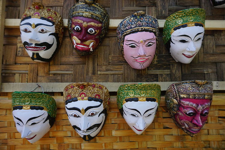 Close-up of masks for sale at market stall
