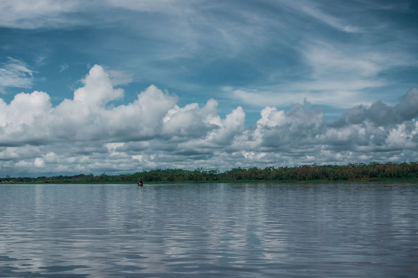 Sky Water Outdoors Day Reflection Nature Cloud - Sky Lake River Travel Destinations Adventure Amazon Rainforest Jungle South America Latin America Waterfront Tranquility Non-urban Scene No People Rippled Idyllic Plant Tree Beauty In Nature Capture Tomorrow Human Connection A New Perspective On Life