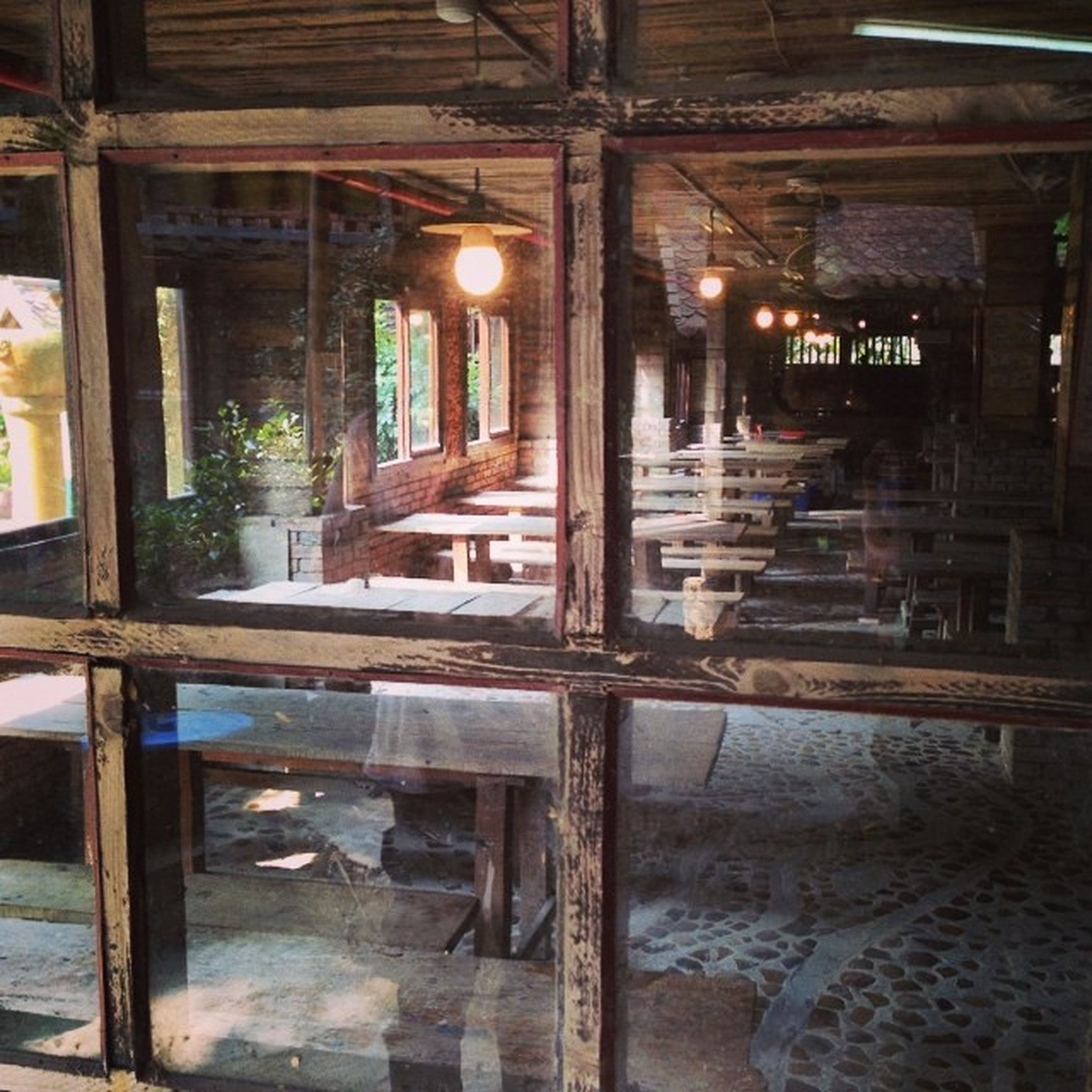 indoors, built structure, architecture, window, interior, reflection, abandoned, old, glass - material, obsolete, empty, damaged, wood - material, absence, architectural column, no people, run-down, building, building exterior, day
