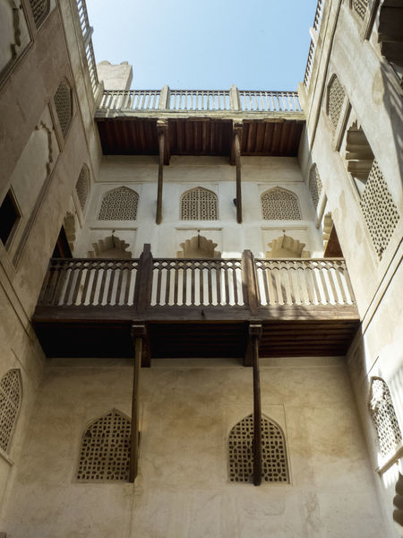 wall detail of an omani fortress with ancient balcony and windows Ancient Fort Arabic Architecture Arabic Balcony Arabic Fort Arabic Window Architecture Balconi Balcony In Oman Clay Walls Jabreen Castle No People Ocher Color Ocher Walls