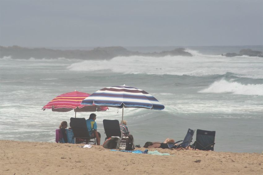 Holiday Beach Group Of People KwaZulu-Natal Coast Leisure Activity Lifestyles Nature Outdoors Real People Relaxation Sand Sea Shore Sitting Summer Togetherness Umbrellas Vacations Water Weekend Activities