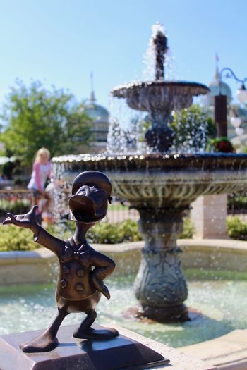 Vacation DisneyWorld Duck Disney Waterfountain Fountain Water Motion Outdoors Day Focus On Foreground Drinking Fountain Spraying No People Architecture Statue Close-up Building Exterior Sculpture Sky Clear Sky Nature City Coin-operated Binoculars