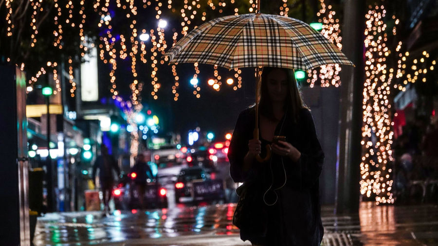 The world lit up around her.. Urban Rain Candid Travel Destinations Travel Tranquility Australia Happiness Hanging Out EyeEm Best Shots EyeEm Gallery EyeEmNewHere EyeEm Nature Lover EyeEmBestPics Streetphotography Woman Girl Yellow Music Night Nightphotography A New Beginning City Umbrella Silhouette Urban Scene Street Light Colorful Rainy Season Monsoon This Is Natural Beauty The Modern Professional International Women's Day 2019 The Art Of Street Photography