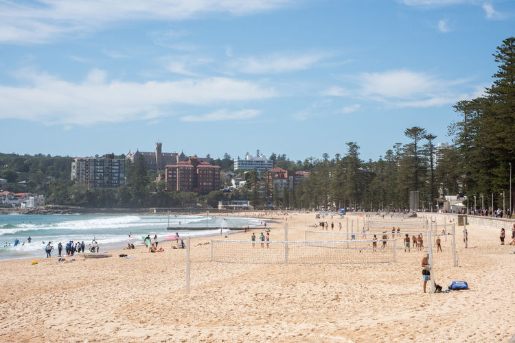 Manly,Sydney,Australia-December 21,2016: Scene with tourists, volleyball nets and waterfront architecture at Manly Beach in Sydney, Australia Manly  Australia Sydney Sea Group Of People Nature Beach Water Pacific Ocean Shore Architecture Crowd Volleyball Beach Volleyball Leisure Activity Recreational Pursuit Vacations Travel Destinations Lifestyles Active Sport Enjoying Life Holiday Outdoor Pursuit Socializing