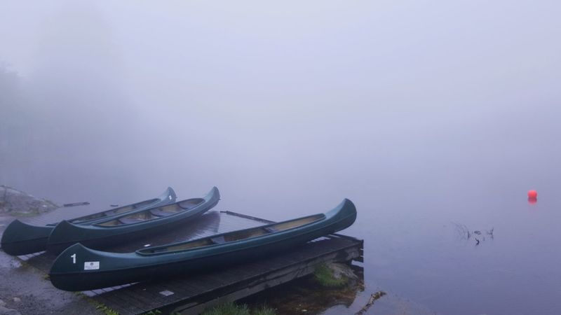 Fog Water Landscape Rowboat Travel Destinations Outdoors Travel Tranquility Nature No People Day Eery Eery Glow Misty Moored Floating On Water Deserted Alone EyeEm Selects EyeEmNewHere Perspectives On Nature