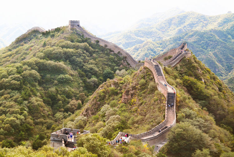 Aerial view of people at great wall of china on mountain
