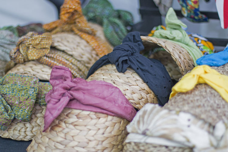 Close-up of straw hats for sale in market