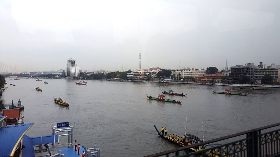 High angle view of river in city against sky