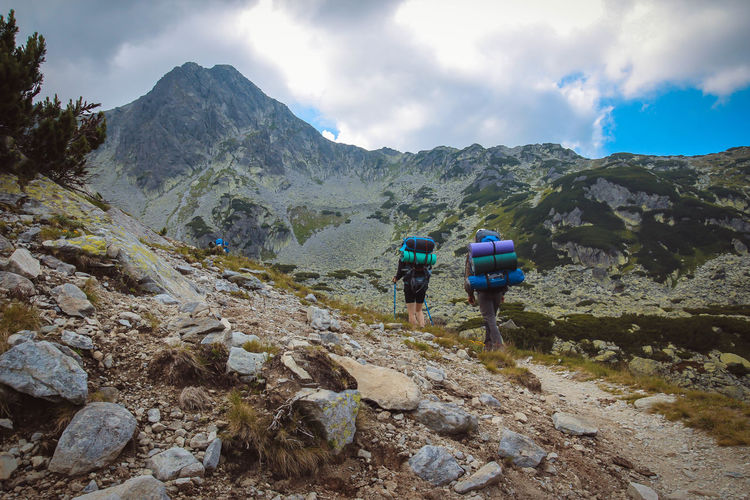 Retezat mountains Adventure Backpack Beauty In Nature Cloud - Sky Day Exploration Friendship Hiker Hiking Hiking Pole Leisure Activity Lifestyles Men Mountain Mountain Range Nature Real People Rear View Rock - Object Scenics Sky Togetherness Travel Two People Walking