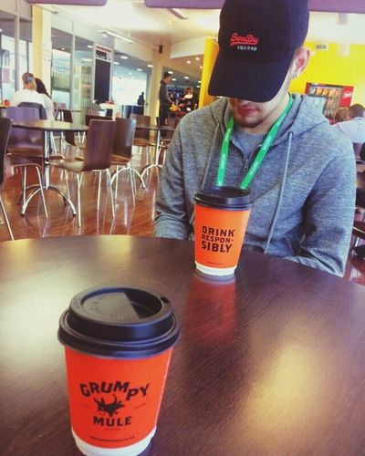 Cafe Son College Newmember Coffee Communication One Person Text Western Script Indoors  Drink EyeEmNewHere Food And Drink Adult Young Men Cap Hat