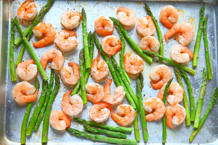 Close-up of prawns and asparagus in plate