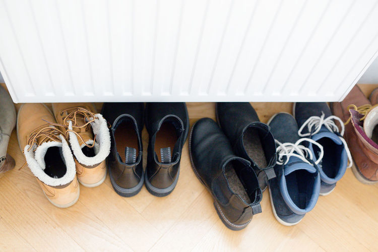 Shoes Flooring Indoors  Pair High Angle View Shoelace Group Of Objects Boot Choice In A Row Side By Side Personal Accessory No People Shoe Dress Shoe Menswear Wood Variation Blue Shoes Brown Shoes Chelsea Boots White Copy Space No Text Order Wood - Material Black Shoes Winter Shoes