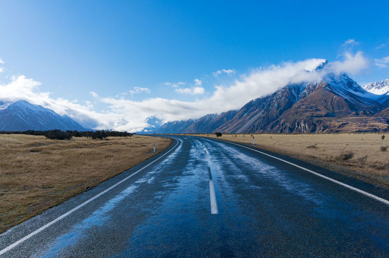 Road in mountain valley. Mount Cook National Park. New Zealand Road Mountain New Zealand Landscape Winter Snow Peak Picturesque Scenery Nature Season  South Island Te Waipounamu Mountain Road Aotearoa Canterbury Vast Beautiful Nobody Spectacular Sky Trip Travel Transportation