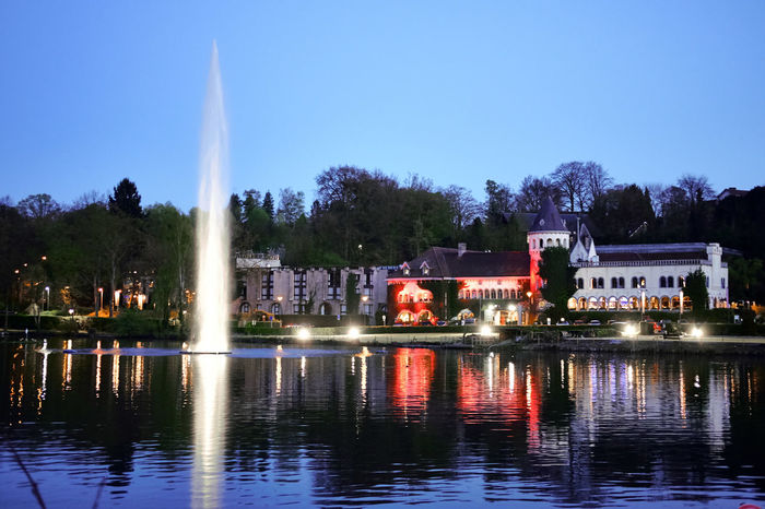 Genval Castle at dusk - Architecture Artesian Well Blue Hour Building Exterior Built Structure Castle Clear Sky Dusk Fountain Genval Illuminated Nature Night No People Outdoors Reflection Sky Tree Water Waterfront