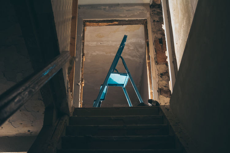 Low angle view of step ladder in abandoned home