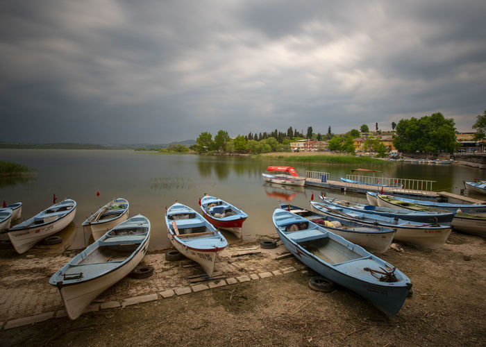 Rowboat Tranquil Scene Overcast Plant Beach Outdoors Scenics - Nature Tranquility Day No People Lake Nature Mode Of Transportation Transportation Sky Moored Cloud - Sky Nautical Vessel Water Long Exposure Gölyazı Kayık Bulut
