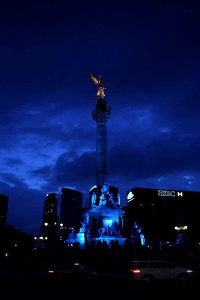 Vertical City Night Nightshot Independence Monument Mexican Culture Mexican History Mexico City Vertical City Architecture Night No People City Life Skyscraper Building Exterior Modern Outdoors Sky Illuminated Angel Of Independece. Cdmx Blue Color