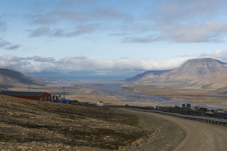 Longyearbyen's view Arctic Summer Beauty In Nature Cityscape Cloud - Sky Extreme Terrain Extreme Weather EyeEmNewHere Landscape Longyearbyen Miles Away Mountain Mountain Range Nature North Norway Outdoors Road Sky Small Town Svalbard  Travel Travel Destinations Travel Photography Miles Away