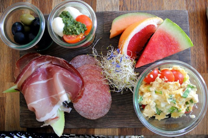 High angle view of breakfast on wooden board
