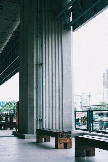 Bridge by buildings in city against sky