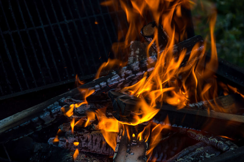 Close-up of fire on barbecue outdoors