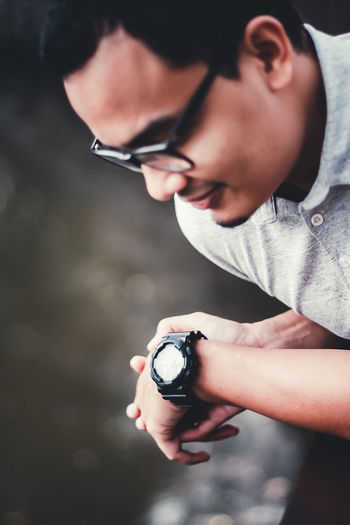 Close-up of man checking time