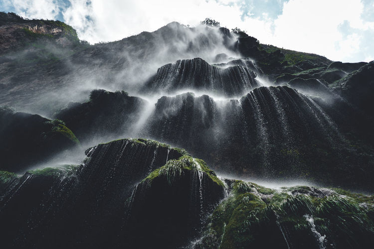 Scenics - Nature Beauty In Nature Waterfall Motion Long Exposure Water No People Nature Flowing Water Blurred Motion Solid Rock Non-urban Scene Environment Rock - Object Outdoors Mountain Plant Land Flowing Power In Nature Rainforest Falling Water Running Water