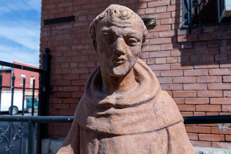 Close-up of statue against building