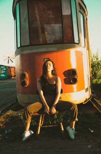 Portrait of woman sitting at train