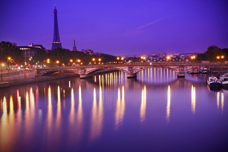 View from Pont Alexandre III in Paris, with Seine River and Eiffel Tower on background. Copy Space Eiffel Tower France Paris Paris, France  Pont Alexandre III Reflection Seine Seine River Tour Eiffel Tour Eiffel, Paris. Travel Twilight Building Exterior Built Structure Dawn Dusk Illuminated No People River Sky Travel Destinations Water