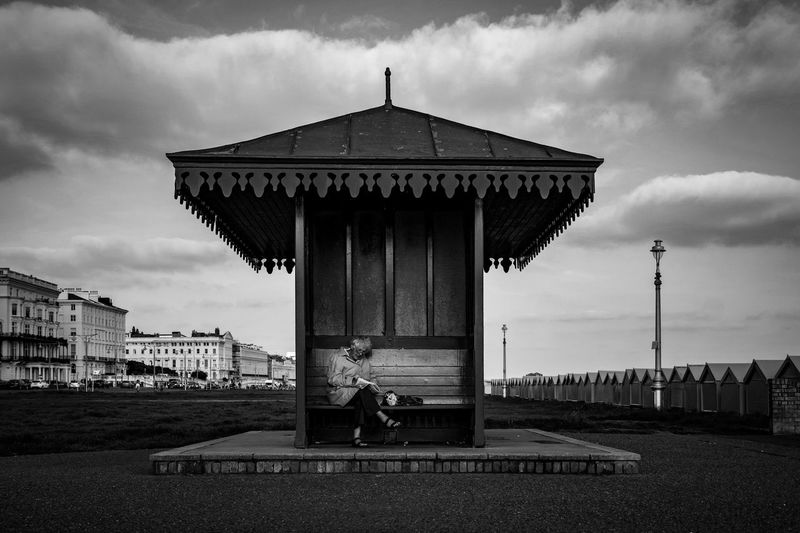 Sudoku alone Streetphotography Streetphoto_bw Street Photography Black And White British Summer Seaside Brighton Beach Brighton Lady Lonely Sudoku Sky Cloud - Sky Built Structure Architecture Building Exterior Nature Day Building City Silhouette First Eyeem Photo Sitting Outdoors One Person Adult The Street Photographer - 2018 EyeEm Awards