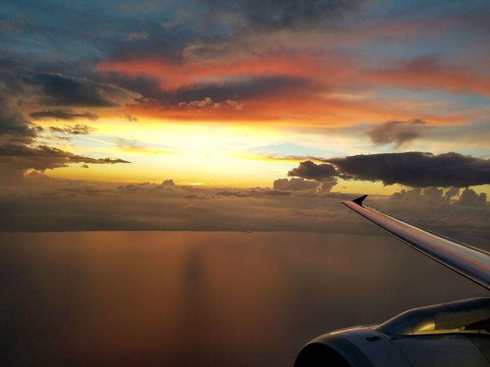Airplanewing Sky And Clouds EyeEmBestPics FriendlySkies Horizon Over Water FriendlySkies Travel Photography Eyeemtravel  Sea Water Sunset Scenics Transportation Tranquil Scene Horizon Over Water Tranquility Beauty In Nature Part Of Cloud - Sky Idyllic Sky Orange Color Cloud Calm Mode Of Transport