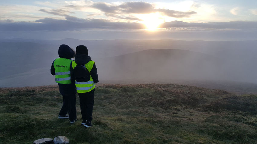 Clouds On The Horizon Dawn Dramatic Sky Full Length Hilltop View Outdoors Shared Experience Standing Sunrise Togetherness Two People Up Early