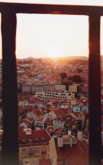 Listening to a song in the background while watching the sunset #Lisboa Film Emulation Film EyeEm Gallery Europe Lisbon Portugal Architecture Sky Built Structure Sunset Building Exterior City Nature Cityscape Building Sun No People Sunlight Clear Sky Orange Color Lens Flare