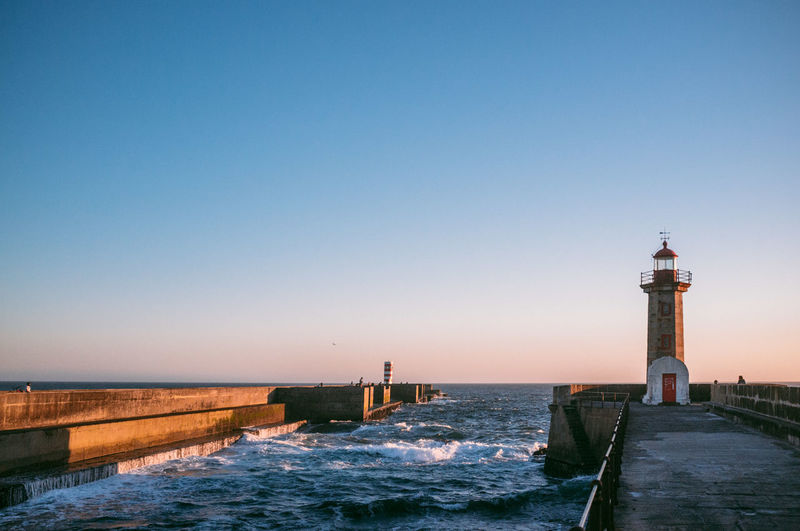 Scenic View Of Lighthouse By The Ocean