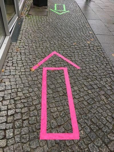High angle view of arrow symbol on street