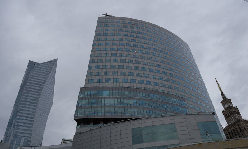 Poland Warsaw Europe Building Exterior Built Structure Architecture Low Angle View Building Office Building Exterior City Modern Sky Skyscraper Office Tall - High Tower No People Nature Cloud - Sky Glass - Material Day Travel Destinations Outdoors Financial District  Spire