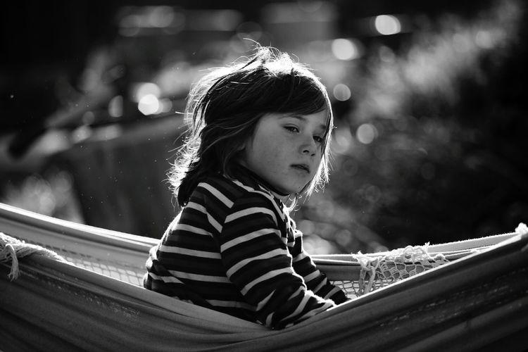 Girl in hammock looking away
