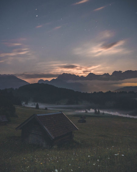After my Abitur I went to Austria with some of my friends. It was one of the best weeks in my life. For this spot we crossed the border back to germany and had a little spontaneous adventure! Cabin Lake Lake View Fog Mist Stars HUAWEI Photo Award: After Dark Astronomy Tree Rural Scene Space Star - Space Agriculture Springtime Tea Crop Atmospheric Mood Dramatic Sky Romantic Sky Moody Sky