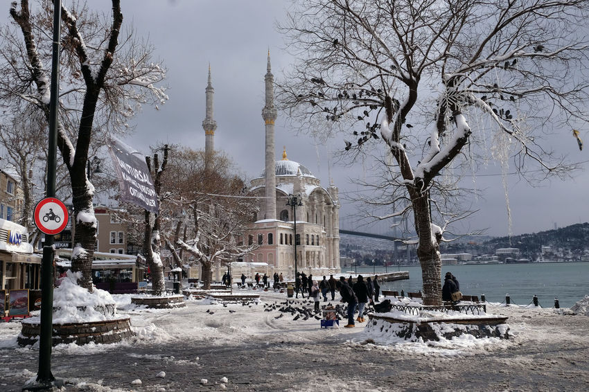Snowy square in front of Ortaköy Mosque at the Bosporus in Istanbul At The Bosporus Covered With Snow Islamic Architecture ISLAM♥ Istanbul Istanbul Turkey Lots Of Snow Masses Of Snow Ortaköy Mosque People And Places People In The Background Sultan's Mosque Tree With Snow Winter In Istanbul Winter Time