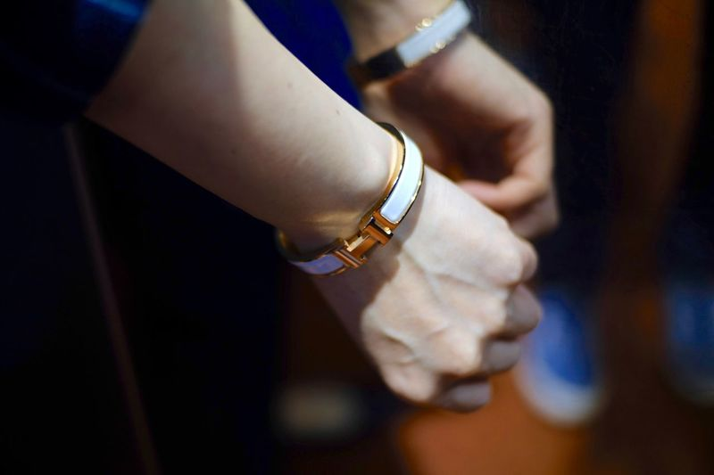 Cropped hands of woman wearing bangles
