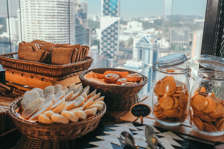 Close-up of cakes in basket high above the city
