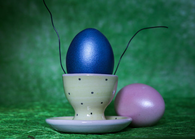 Story Photography Blue And Green CELEBRATION DAY Green Backgound Easter Dekoration Colored Eggs Egg Story Easter Egg Eggcup Easter Green Color Freshness Fragility No People Indoors  Egg Food