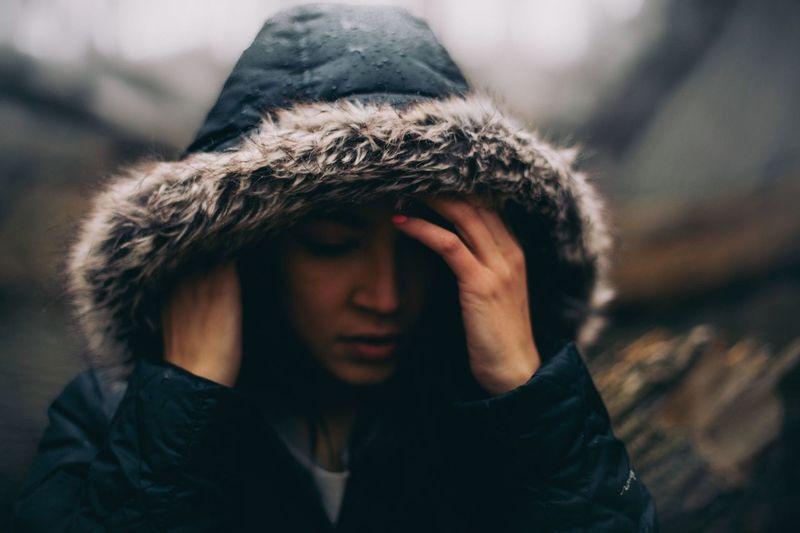Woman wearing fur jacket during rainy season