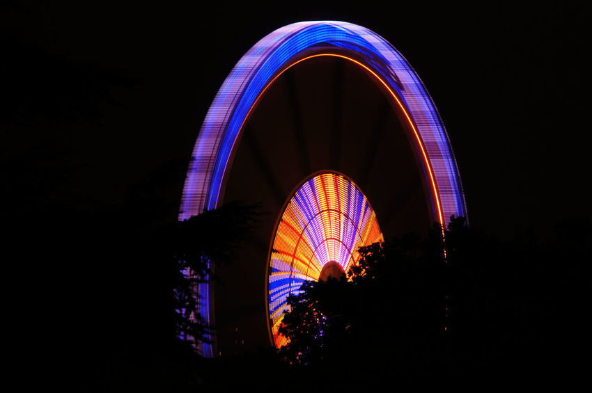 Ferris Wheel at Night Amusementpark Arch Architecture Arts Culture And Entertainment Available Light Blue Built Structure Circle Of Light City Coloured Coloured Lights Ferris Wheel Illuminated Kramermarkt Oldenburg Low Angle View Night Sky Tourism