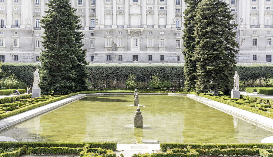 Pond against royal palace of madrid