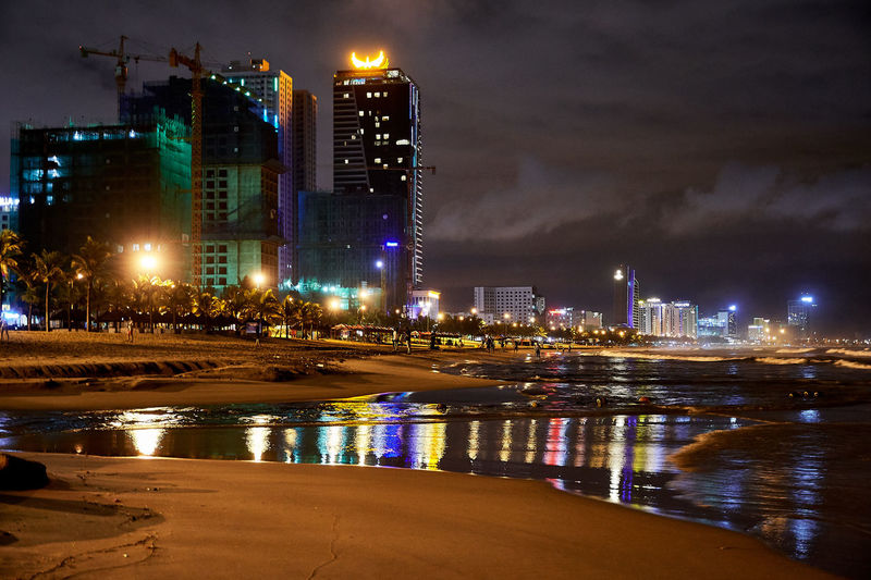 EyeEmNewHere Vietnam Architecture Building Exterior Built Structure City Cityscape Coloredlights Danangbeach Illuminated Modern Night No People Outdoors Reflections Sky Skyscraper Travel Destinations Urban Skyline Water