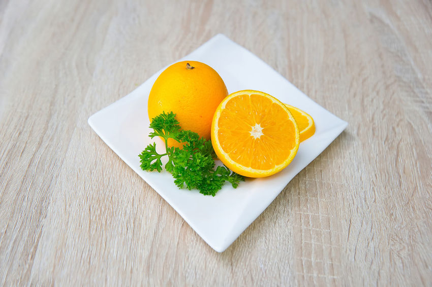 Oranges in a white plate on a wooden table Delicious Food Food And Drink Food And Drink Freshness Freshness Healthy Eating Healthy Food Indoors  Indulgence Ingredient Mandarin Oranges Meal Orange Organic Plate Ready-to-eat Serving Size Spice Spinach Still Life Sweet Table Vegetable Vitamin