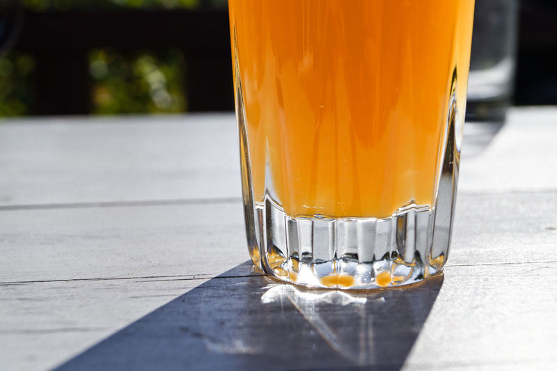Close-up of juice in glass served on table